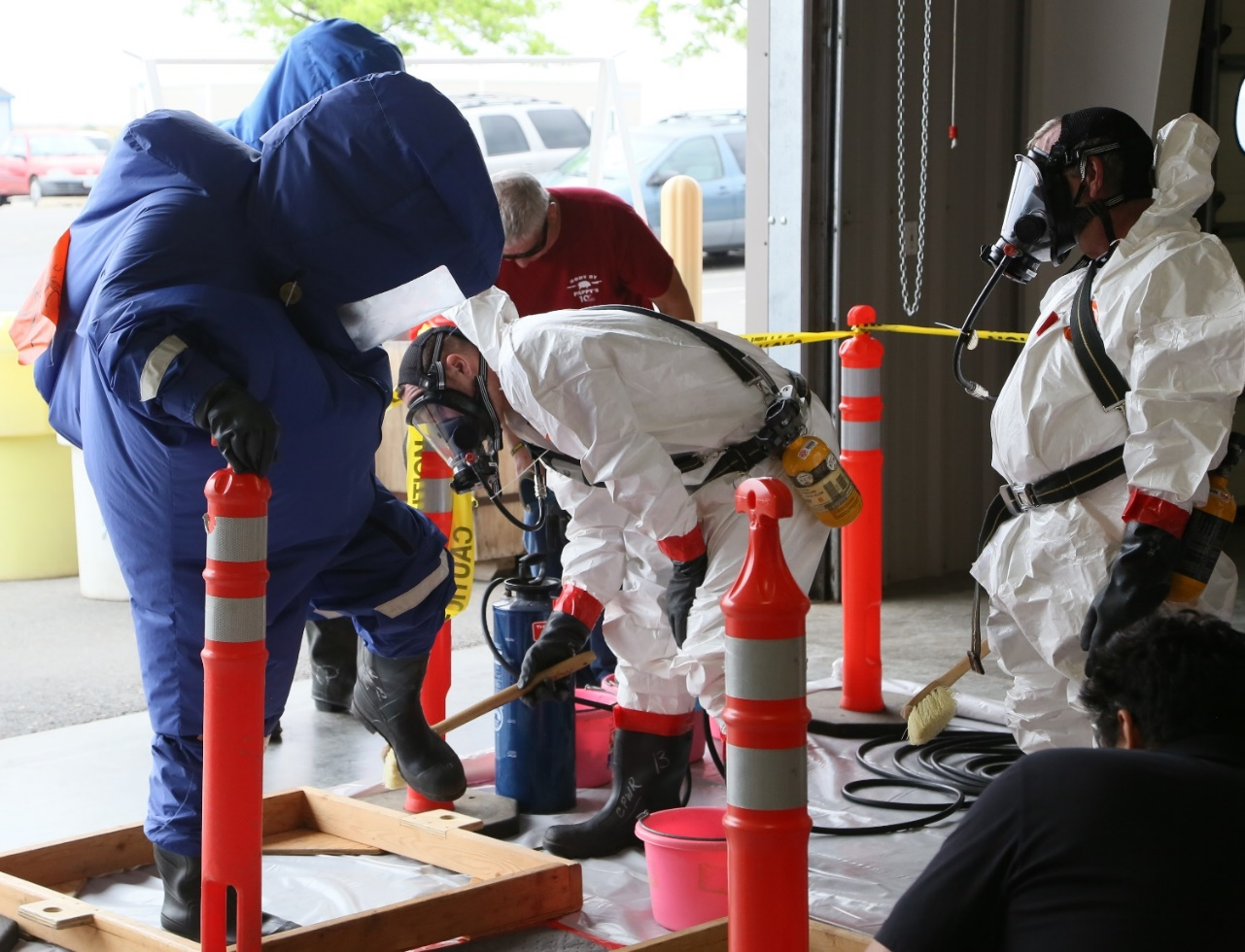 Workers go through a decontamination line as part of a 40-hour hazardous waste training course at HAMMER.