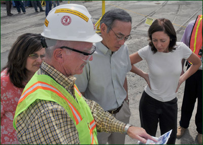 Washington Closure Hanford President Chuck Spencer, foreground, briefs Assistant Secretary for Environmental Management Ines Triay, left, Secretary of Energy Dr. Steven Chu, center, and U.S. Sen. Maria Cantwell, right, during the Secretary's visit to Hanford's N Reactor on Aug. 11, 2009.