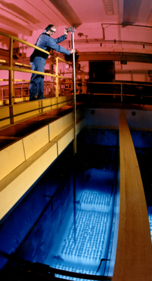 The water around the cesium and strontium capsules in the Waste Encapsulation and Storage Facility pools glows a color of blue. The effect is known as the Cherenkov Glow, as the radioactive cesium and strontium decay and lose their radioactivity to become stable atoms.